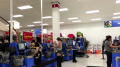 People paying foods at self check out counter inside Walmart store Stock Footage