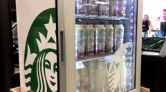 Woman buying Starbucks doubleshot energy plus coffee Stock Footage