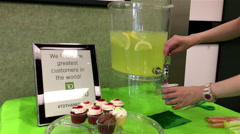 Woman pouring lime drink inside TD Bank Stock Footage