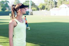 Sporty girl on the stadium Stock Photos