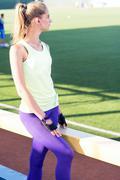 Sporty girl on the stadium - stock photo