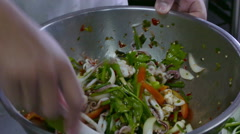 4K footage chef cooking a vegetable salad with seafood, Thai spicy style Stock Footage