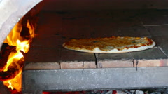 4K footage of Pizza in fire wood oven Stock Footage