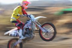 Motocross biker on dirt track Stock Photos