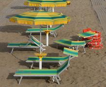 Many umbrellas in sandy beach seen from above in summer Stock Photos