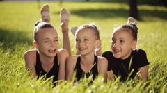 Happy teenage friends having fun in spring park Stock Footage