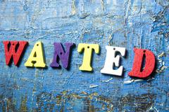 Wanted word written on colorful wooden abc latter Stock Photos