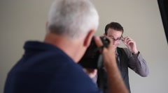 Model on a photo shoot session Stock Footage
