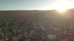 4K Aerial view houses top of hills sunset shine bolivia Stock Footage