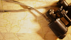 Vintage binocular on map background Stock Footage