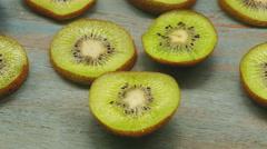 Close up shot of Kiwi fruit on wood background Stock Footage