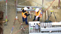 Two unrecognized civil engineers inspecting construction site Stock Footage