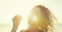 Young Woman Blowing Bubbles Stock Footage