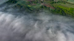 Flying above landcape with mist Stock Footage