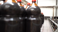 Close up of plastic bottle industry on a conveyor belt Stock Footage