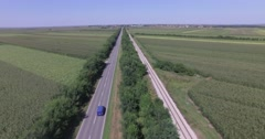 Countryside traffic, aerial, follow the blue van over highway Stock Footage