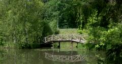 Wooden bridge, pond, Museum - reserve Abramtsevo, Moscow region, Russia Stock Footage