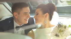 Happy Newlyweds Having Fun in a Limo Stock Footage