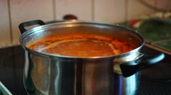 Boiling soup on stove Stock Footage