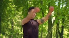 Fitness man exercising in park. Fitness exercise. Sport guy warming up outdoor Stock Footage