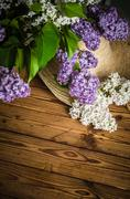 Bouquet of lilacs and a straw hat, close-up Stock Photos