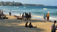 Australia Sydney Manly Beach surfers with waves Stock Footage