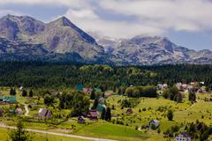 Scenic view of mountain landscape , village in green valley and forest at sum Stock Photos