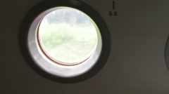Airplane window view from the inside Stock Footage