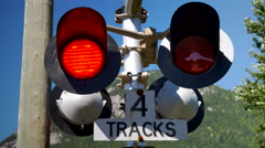 4K Zoom In Railroad Crossing Train Sign, Red Light Signal Close Up Stock Footage