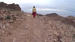 Man walks in the mountains of Petra. Jordan, desert Stock Footage