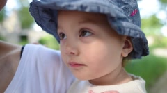 Baby girl wearing hat in summer Stock Footage