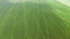 Tractor sprinkles bean field Stock Footage