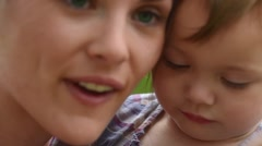 Mother and daugther cuddling in countryside - stock footage