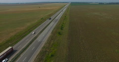 Aerial of cars traffic on a country highway in summer Stock Footage