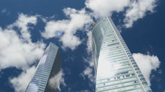 Clouds reflected on modern glassy corporate building. Time Lapse Stock Footage
