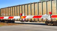 4K Seamless Looping Shot of Train Passing, Flashing Train Crossing Barrier Stock Footage