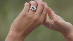 Couple in love holding each other's hands. Close-up Stock Footage