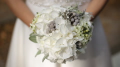 Beautiful bride sniffing the flowers close up Stock Footage