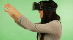 Girl in virtual reality is smilling and it makes him laughing. Green screen - stock footage