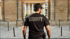 4K Security Guard in Black Uniform, Protection Officer in front of Gate Stock Footage