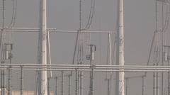 Smoke from hot wildfire approaches electrical grid equipment Stock Footage