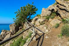 Trail Golitsyn - Falcon Path a mountain pathway carved on the side of Koba-Kaya - stock photo