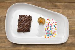 chocolate mousse on plate  and confectionery  sprinkling - stock photo
