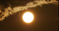 Sunset with Large Orange Glowing Sun with Clouds 10bit, 4K - stock footage