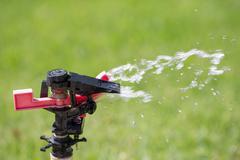 Watering grass sprinkler - stock photo