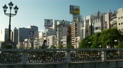 Fukuoka -  People walking on the bridge in evening light. 4K resolution. Stock Footage
