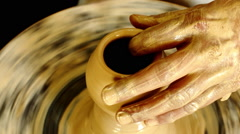 Bahrain pottery worker making clay pots Stock Footage