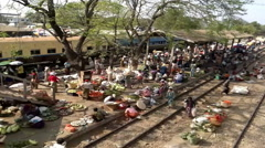 A large market on the station platform and along the rail track Stock Footage