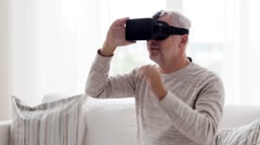 Old man in virtual reality headset or 3d glasses 79 Stock Footage