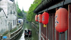 Old wooden boat floats down a canal in Suzhou. Stock Footage